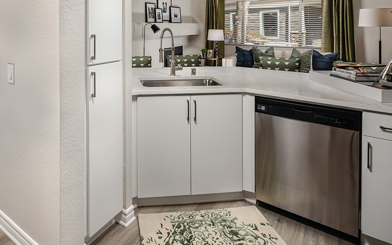 Spacious kitchen with wood floors and stainless steel appliances.